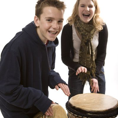 girl and boy drumming